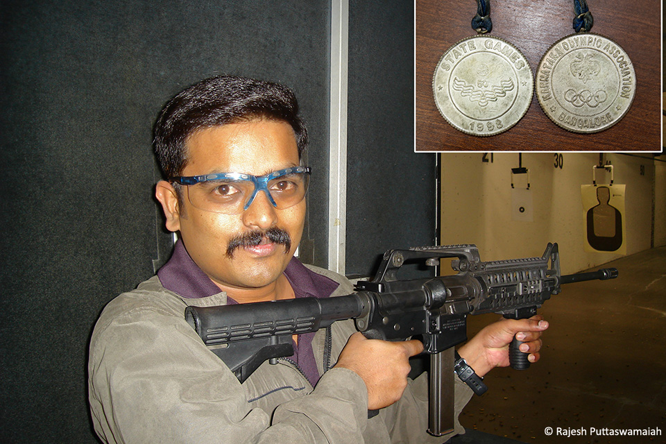 Trying an automated AR-15 assault rifle during a visit to a shooting range in Redmond, WA, USA.  Inset: The two silver medals won at the 1998 Karnataka State Olympics.
